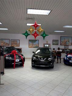 Xmas decor for car showroom Balloon Arrangements, Balloon Decorations, Xmas Decorations, Balloon Ceiling, Ceiling Decor, Showroom, Balloon Cars, Christmas Balloons, Xmas Holidays