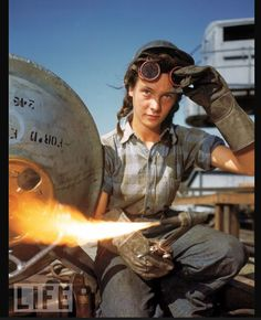 WWII in color! A welder at a boat-and-sub-building yard adjusts her goggles before resuming work, October, 1943. By 1945, women comprised well over a third of the civilian labor force (in 1940, it was closer to a quarter) and millions of those jobs were filled in factories: building bombers, manufacturing munitions, welding, drilling, and riveting for the war effort.