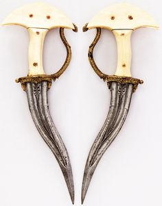 Indian khanjarli, 17th to 18th century, steel, ivory, gold, ruby, H. 11 1/2 in. (29.2 cm); L. of blade 7 3/8 in. (18.7 cm); W. 4 1/4 in. (10.8 cm); Wt. 9.4 oz. (266.5 g), Met Museum, Bequest of George C. Stone, 1935.