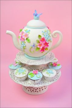 tea pot cake, would look even better if the cupcakes were teacups