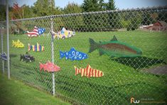 Chain Link Fence With Fish -- or flowers or bees or whatever. Painted wood is attached with zip ties.