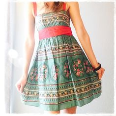 SALE!!Floral Print Sundress NWOT Floral print sundress in vibrant turquoise and red. Red shoulder straps and ribbon tie waist accentuating the a-line skirt. Pair with heels or ballet flats for a Mad Men-esque look!! Dresses