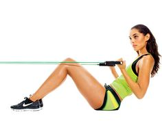 Resistance Band Workout: Work biceps and abs with the 'Flex & Crunch.' Anchor center of band about 2 feet off floor and sit with feet flat, holding handles in front of you, palms up; curl handles toward you so biceps engage. Lie back (as shown) to floor; sit up, biceps still engaged. Do three sets of 12 reps. #SelfMagazine