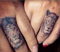 Lion and Lioness tattoo on the ring finger