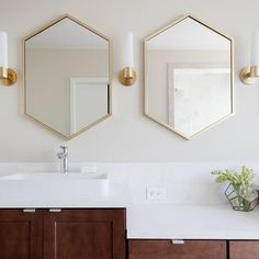 metal hexagon framed mirror - antique brass have these for upstairs master bath