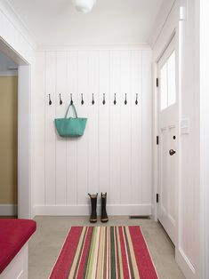 Albertsson Hansen Architecture: Crisp white tongue and groove walls pair with a craftsman style front door. The paneled ... Coat Hooks On Wall, Hall Furniture, Door Trims, House On A Hill, Office Walls, Entrance Hall, Mudroom, Home Decor Inspiration, Home Remodeling