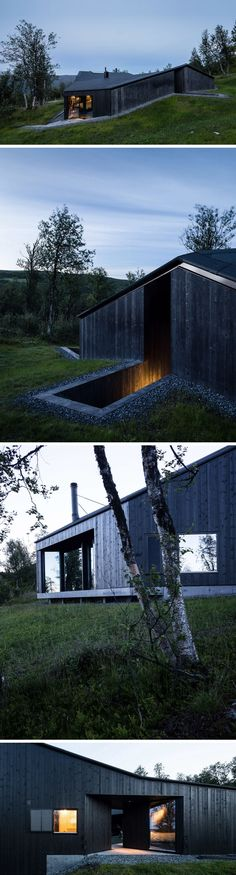 Blackened wood siding on this modern cabin allows the light coming from inside to cast a warm glow outside and gives the cabin a cozy look.