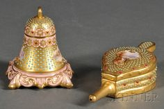 """Two Small Coalport """"Jeweled"""" Porcelain Articles, late 19th/early 20th century, comprising a bellows-form box, with gold ground with faux turquoise and ruby """"jewels,"""" lid with reserve with a small landscape, pink glazed interior, lg. 4 3/4, and a bell-shaped inkwell, with gold ground, the body with turquoise jewels and two small landscape reserves, with faux pearl and ruby jewels at rims, pink accenting"""