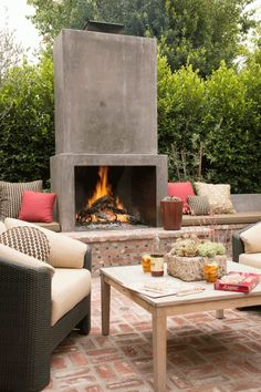 An outdoor fireplace design on your deck, patio or backyard living room instantly makes a perfect place for entertaining, creating a dramatic focal point. Rustic Outdoor Fireplaces, Outdoor Fireplace Designs, Backyard Fireplace, Backyard Patio, Fireplace Ideas, Concrete Fireplace, Stucco Fireplace, Fireplace Seating, Fireplace Wall
