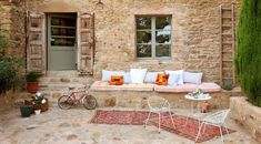 Patio with iron chairs and rugs