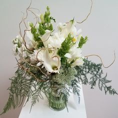 Wedding bouquet - bells of Ireland, calla lilies, freesia, stock, disbud mums, queen annes lace, plumosa and curly willow tips