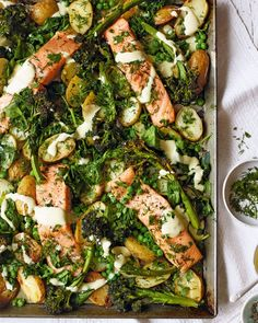Our healthy salmon and broccoli traybake is packed with fresh herbs, potatoes and drizzled in a mustard sauce, all for under 500 calories per serving. Tray Bake Recipes, Sauce Recipes, Fish Recipes, Seafood Recipes, Vegetarian Recipes, Cooking Recipes, Healthy Recipes, Lasagna Recipes, Cooking Hacks