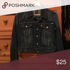 Levi's Denim Jacket Dark wash denim jacket. In great condition ! Only worn a couple times. No signs of wear. I'd say that it is semi cropped and fits tight Levi's Jackets & Coats Jean Jackets