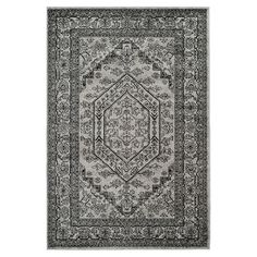 Loomed rug with a classic Persian design.  Product: RugConstruction Material: 100% PolypropyleneColo...