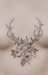 Floral & antler sternum tattoo by Tritoan Ly
