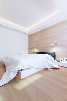 Chambre avec lit éclairé dans un appartement contemporain 100M