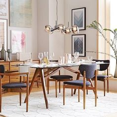 Jensen Dining Table #westelm  If you are up for a glass-top table again, this one is nice; clean, simple lines, legs that flair out a bit.  Glass top reflects lots of light and in your relatively small dining space, a glass top can make the room feel larger.