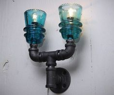 Industrial Theme Pipe Lamps This is almost like something the Adams family would have in their house. I love it!