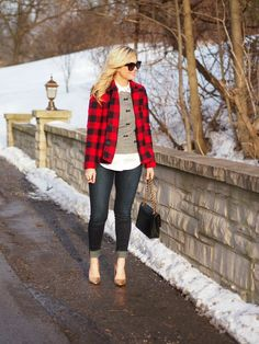White check shirt with grey stylish sweater and red and black stripes stylish coat and dark grey casual plan jeans and black leather hand bag and golden yellow cute high heels pumps