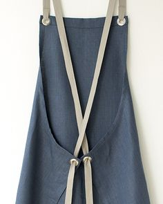 The cross-back linen Kitchen Apron, now in slate-blue, at studiopatro.com.