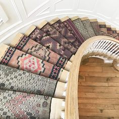 Inexpensive stair runner - Yes, it involves those cute tiny rugs you have no idea what to do with
