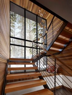 Mid-century #modern #stair details with a view of a snowy #landscape