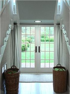 These beautiful French doors offer great light in this hallway. Try treating your doors with shades for light control.