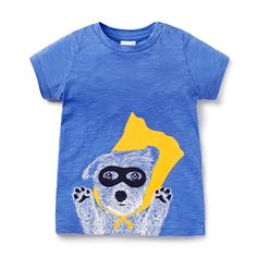 100% Cotton Tee. Jersey, short sleeve t-shirt, Features novelty super dog print on front. Regular fitting silhouette with snaps on baby's left shoulder for easy dressing. Available in Super Blue.
