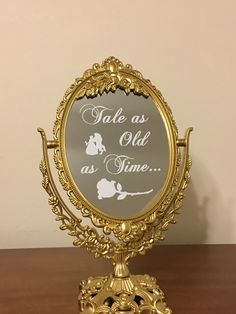 Tale as Old as Time mirror sign