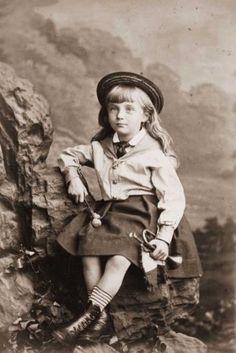 Circa 1860: A young Victorian bugle-horn player.