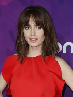 Lily Collins. Those bangs make her look younger.