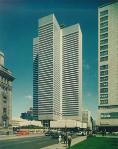 This seven-acre civic and commercial complex transformed Montreal's downtown and sparked the creation of its underground city, a subterranean network of retail space, plazas, and transit. Toronto Architecture, Architecture Design, Commercial Complex, 80s Design, Underground Cities, Tokyo Tower, Urban Planning, Brutalist, Skyscrapers