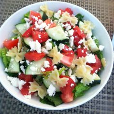 Cucumber, tomato, feta and bow tie pasta salad with lemon vinaigrette  Super easy simple summer salad