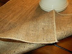 """Burlap Table Runner: (I REALLY WANT A SURGER): My table is 5 1/2 feet long so I made my runner just over 6 feet to have a little hang over each end. I wanted mine to be a little wider than usual so I can layer it with another runner if I want so I cut the piece in half (making it about 40"""" wide). Burlap frays very easily so I used my serger to finish off the sides. If you don't have a serger you could sew a zig zag stitch near the edge, use some fray check, or just leave it as is!"""