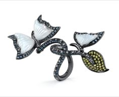 A cocktail ring to converse upon!    A unique creation of hand carved chalcedony, pave yellow sapphires with black and white diamonds.    #butterflies #diamonds #VannaK