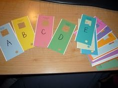 Letter Finders- I used paint chips (free from Lowes) and wrote letters on them. I envision the kids looking through books and using these to find letters. I plan on hooking them all together with a flashcard ring.