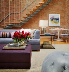 France and son loves the Mid century design in this room, the floating stairs with brick walls, and a dining area.