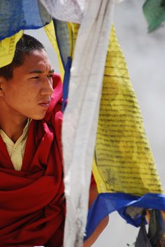 Monk and flags in Zanskar valley  #PlacesToTravelTo   #SomedaySoon