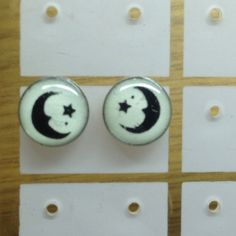 Moon / Star Earrings They glow in the dark! I have two pairs of these and I can sell them both for $9. Jewelry Earrings