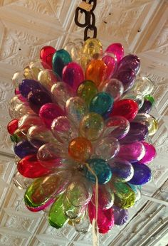 Ha!  I finally got some info on this chandelier!  I first saw it in the book Colorful Home by Susan Hable of Hable Construction.  Then I saw it in a post on Instagram.  It is/was sold at John Derian in NYC, and I think the manufacturer is La Maison d'Alep in France.  It is made of recycled glass from Syria.