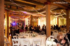Wedding Guests enjoying the evening at a January event. The room was glowing with great mood lighting & smiles of joy! Photographed by The Wedding Studio, Schaumburg IL