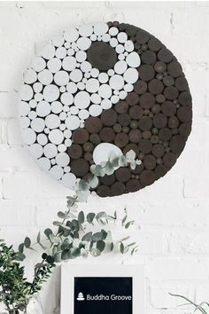 Yin Yang Wall Art, 18 Inches - Polka dots made from wooden branches put a dynamic twist on an ancient symbol. Crafted in Indonesia, this hanging adds texture and color to your space while invoking a sense of balance. Yin Yang measures 18 inches in diameter and 1.5 inches deep. Made with sawtooth hardware for easy installation.