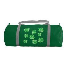 Green Shamrock of Shamrocks Duffle Bags Gym Duffel Bag. The shamrock design is printed on both sides.