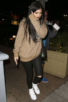 Oversized sweat top, ripped skinny jeans and white sneakers. The youngest of the Kardashian sisters, and one of the hottest celebrities, Kylie Jenner. Look out Kim. Expect Instagram selfies, cute outfits, dope style, fashion, make up and hairstyles. Amazing body, beautiful clothes.