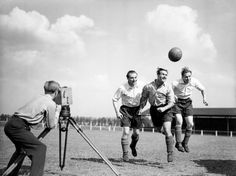 Stanley Matthews, Stanley Mortensen and George Hardwick (left to right) play-act for an instructional film being made by the Football Association, at Hendon in September 1947.