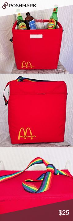 """Vintage 70s McDonalds Picnic Lunch Bag Red Tote Very Rare Collectible Vintage McDonald's Red Nylon Insulated Ice Cooler Large picnic lunch bag with closure and adjustable rainbow colored shoulder strap, it could be a great crafts or knitting sewing bag as well, maybe even a laptop bag Height 13""""  Length 12""""  Depth 6.5"""" Strap Drop 17""""  """"In good used condition. Edges and corners have some marks from usage but bag is sturdy and does not have significant wear. Strap handle is in very good…"""