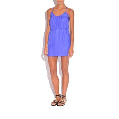 The logan silk dress by Amanda Uprichard features a pleated bodice, strappy racerback, and a cinched waist. Pair this bright colored dress with a statement necklace and sandals for summer outings.