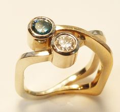 Modern Two tone blue and white diamong ring  www.troyshoppejewellers.com