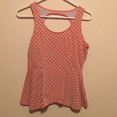 Polka dot peplum top Peach with white polka dots peplum top. Hole cutout on upper back.. Lower neckline Kirra Tops Blouses