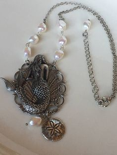 A personal favorite from my Etsy shop https://www.etsy.com/listing/526407387/mermaid-mermaid-jewelry-pearls-sand